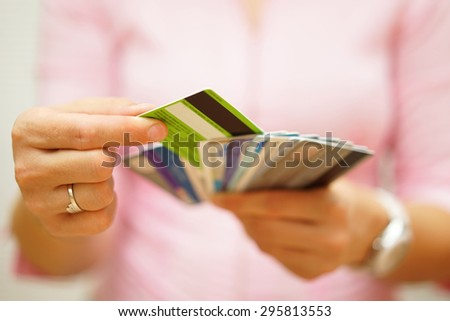 woman choose one credit card from many, concept of  credit card debt, - stock photo