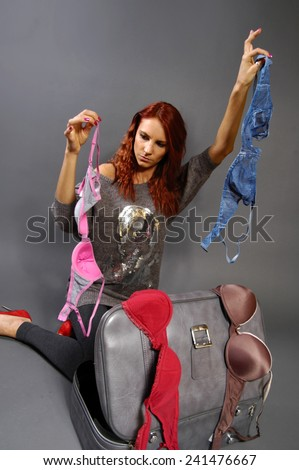 woman chooses clothes - stock photo