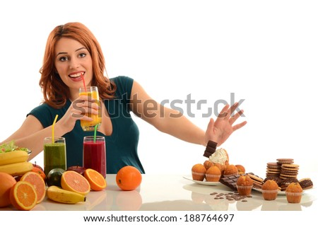 Woman choosing between fruits, smoothie and organic healthy food against sweets, sugar, lots of candies, unhealthy food - stock photo