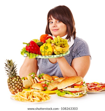Woman choosing between healthy eating and hamburger. - stock photo