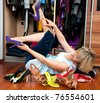 woman choosing shoes in front of the closet - stock photo