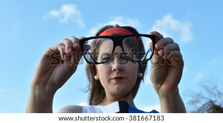 woman cleaning glasses - stock photo