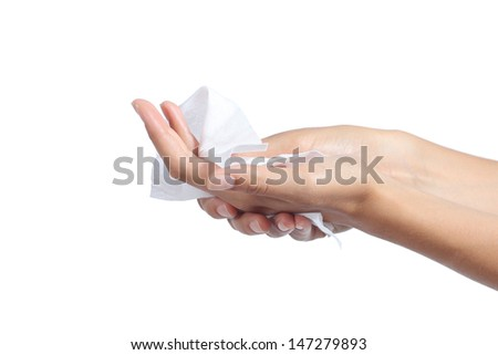 Woman cleaning her hands with a tissue isolated on a white background             - stock photo