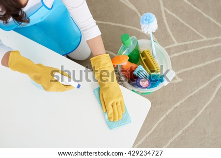Woman cleaning table with detergent, view from above - stock photo