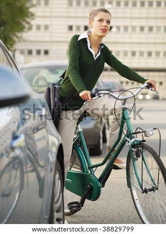 woman commuting on bicycle and looking away - stock photo