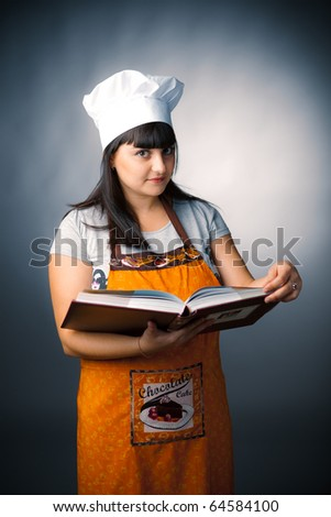woman cook holding a recipes book - stock photo