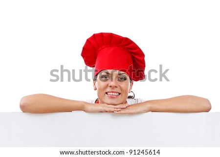 Woman cook looking over paper sign billboard - stock photo