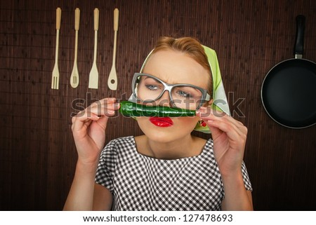 woman cook with hot pepper-close up - stock photo