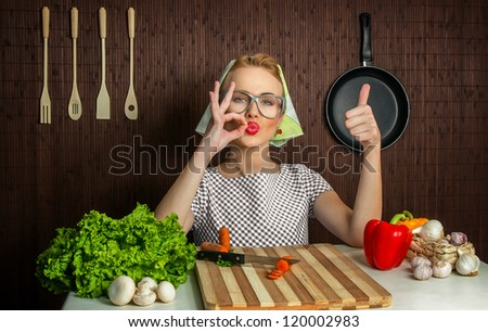 Woman cook with thumb up, yes - stock photo