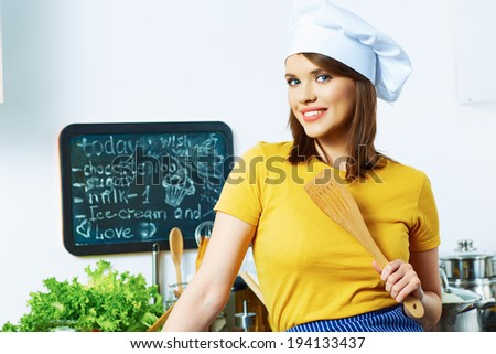 Woman cooking healthy food in kitchen. - stock photo