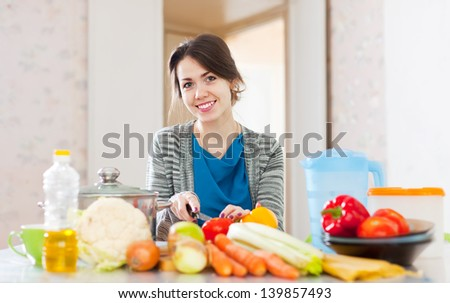woman cooking vegetarian food  in the kitchen at home - stock photo