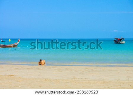 Woman could sunbathe, swim and relax on Phuket sand beach in Southern Thailand - stock photo