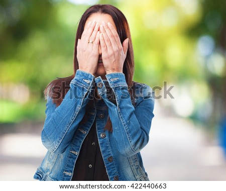 woman covering her face - stock photo