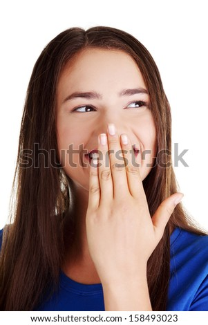 Woman covering mouth with hand,  - stock photo