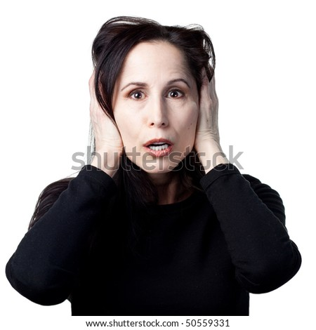 Woman covers her ears after a loud noise - stock photo
