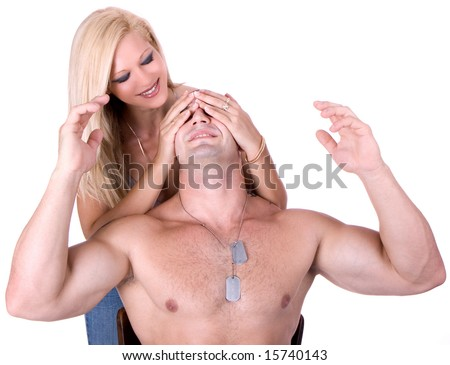 woman covers man's eyes with hands - stock photo