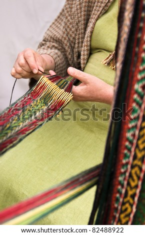 Woman crocheting pattern stripes with traditional tool - stock photo