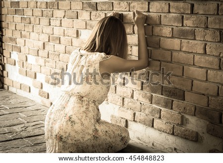 Woman crying with wall. - stock photo