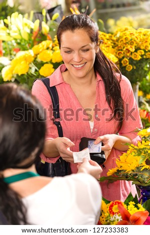 Woman customer taking receipt flower shop buying credit card - stock photo