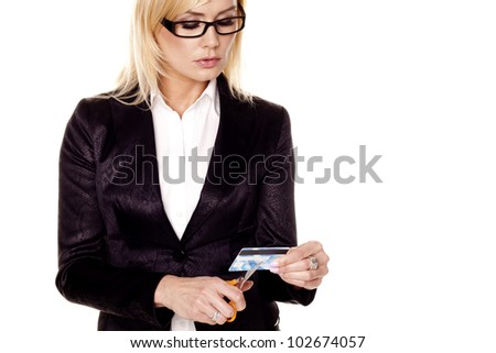 Woman cutting credit card. A blond businesswoman cutting up an expired credit card on a white background. - stock photo