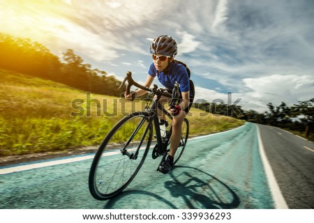Woman Cycling outdoor exercise bike paths - stock photo