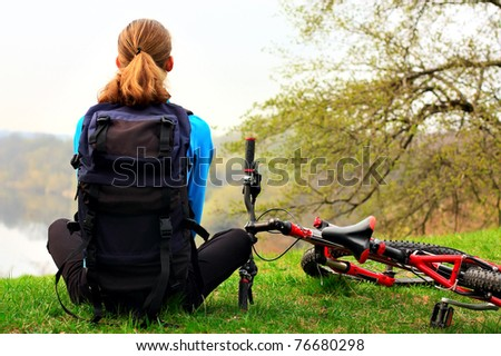 Woman cyclist on a halt. Travel and outdoor recreation. - stock photo