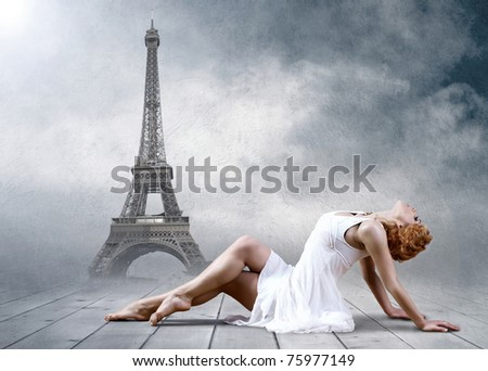 Woman dancer seating posing on the Eifel tower background - stock photo