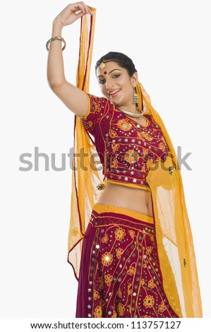 Woman dancing in bright red lehenga choli - stock photo
