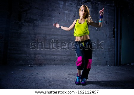Woman dancing in urban environment  - stock photo