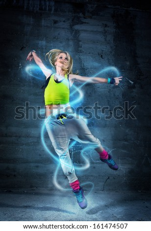 Woman dancing in urban environment with abstract lines - stock photo