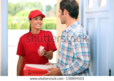 Woman delivering pizza - stock photo