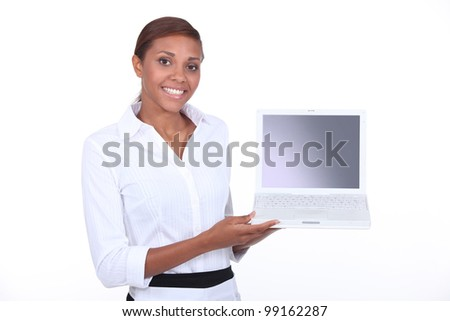 Woman demonstrating a laptop computer with a blank screen - stock photo