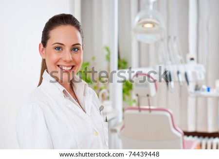 woman dentist at her office smiling - stock photo
