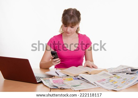 Woman dials the phone book - stock photo