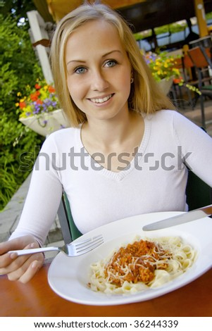 Woman dinning in restaurant. - stock photo
