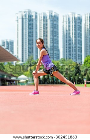 Woman do warm up exercise at sport arena - stock photo