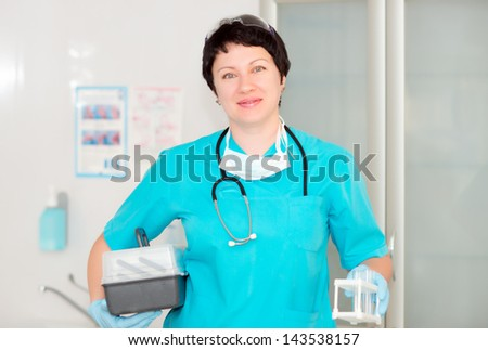 Woman doctor assistant. nurse holding a plastic test tube - stock photo