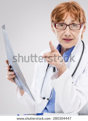 Woman doctor at work - stock photo