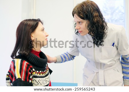 Woman doctor examines the patient's eye - stock photo