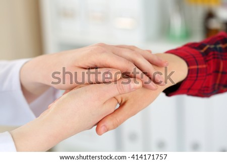 Woman doctor hands holding female child patient hand. Partnership, medical ethics, patient cheering, news lessening, physician make round, physical, examination, 911, healthy lifestyle concept - stock photo