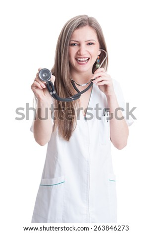Woman doctor pointing or holding stethoscope to the camera on white background - stock photo