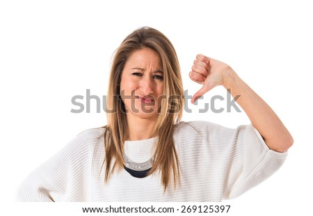 Woman doing a bad signal - stock photo