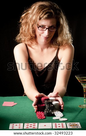 Woman doing all-in playing poker - stock photo