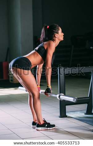 woman doing deadlift in the gym - stock photo
