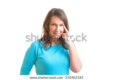 Woman doing EFT on the side of eye point. Emotional Freedom Techniques, tapping, a form of counseling intervention that draws on various theories of alternative medicine.  - stock photo