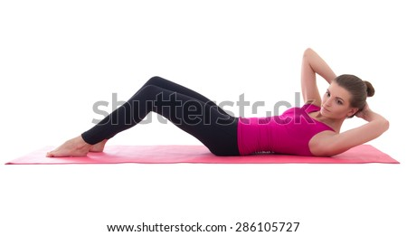 woman doing exercises for abdominal muscles isolated on white background - stock photo