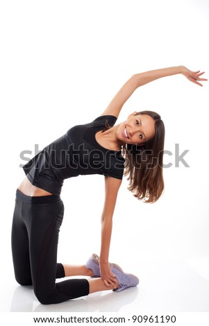 woman doing gymnastics on white background studio - stock photo