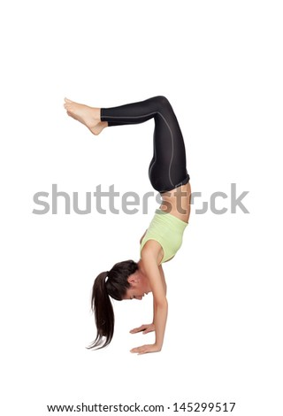 Woman doing handstand isolated on white background - stock photo