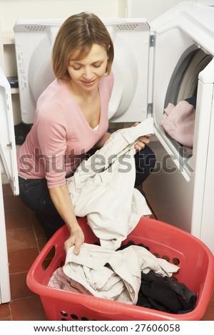 Woman Doing Laundry - stock photo