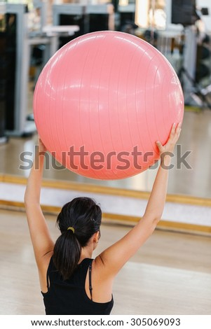 Woman Doing Pilates Exercises with a Ball - stock photo